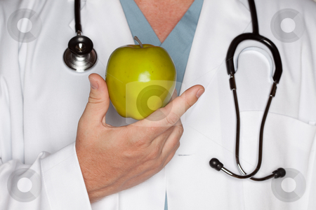Male Doctor Holding Green Apple stock photo, Male Doctor with Stethoscope Holding Green Apple. by Andy Dean