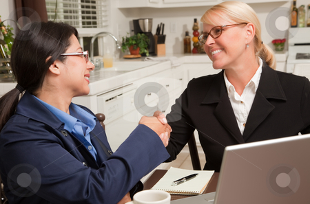 Businesswomen Shaking Hands Working on the Laptop stock photo, Businesswomen Shaking Hands Working on the Laptop Together in the Kitchen. by Andy Dean