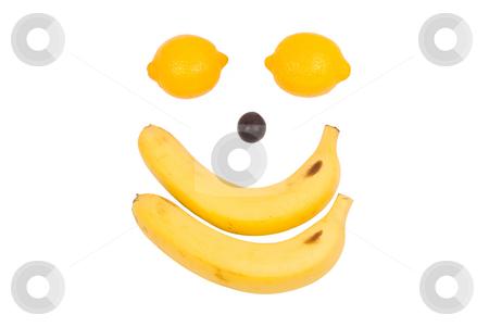 Fruit like man's face. Lemon, banana and grape stock photo, Lemon, banana and grape as man's face by Lawren