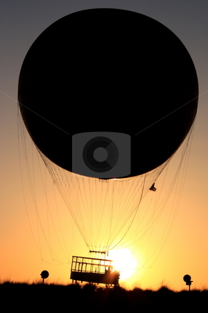 Balloon ride stock photo, A passenger balloon going up at sunset. This noe goes up four hundred feet high at the Great Park in Irvine CA. by Rob Wright