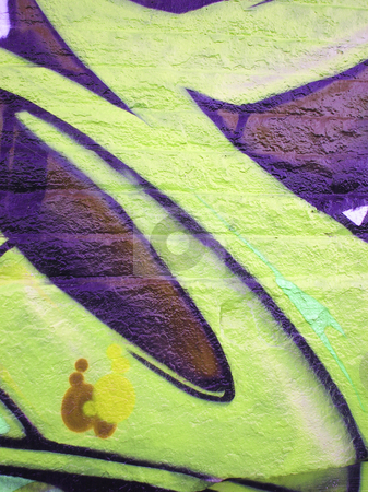 Brightly painted concrete wall stock photo, Bright yellow and purple painted concrete wall by Annette Davis