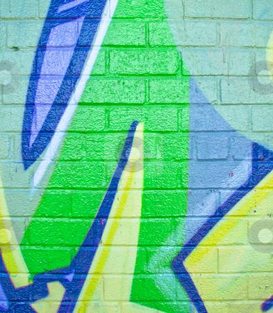 Bright green graffiti on brick wall stock photo, Bright glossy green graffiti on brick wall by Annette Davis