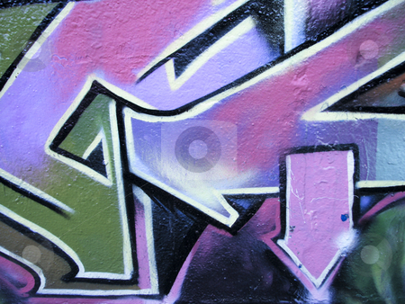 Graffiti arrows on a concrete wall stock photo, Graffiti pink and green arrows on concrete wall by Annette Davis