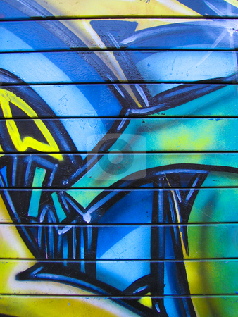 Graffiti painted garage door stock photo, Brightly painted blue, green and yellow abstract background on garage door by Annette Davis