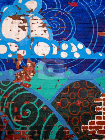 Abstract design painted on brick wall stock photo, Abstract circle and cloud-like design painted on brick wall by Annette Davis