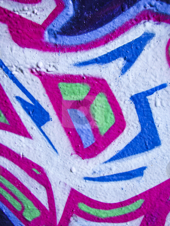 Brightly painted abstract concrete wall stock photo, Bright graffiti on an abandoned derelict building by Annette Davis
