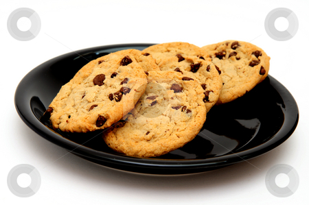 Chocolate Chip Cookies stock photo, Chocolate Chip Cookies on a glossy black saucer with a white background by Lynn Bendickson