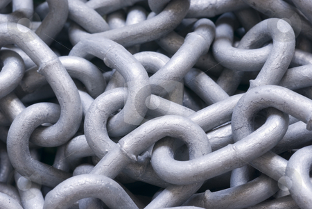Chains stock photo, A tangled backdrop of metal chain links by Stephen Gibson