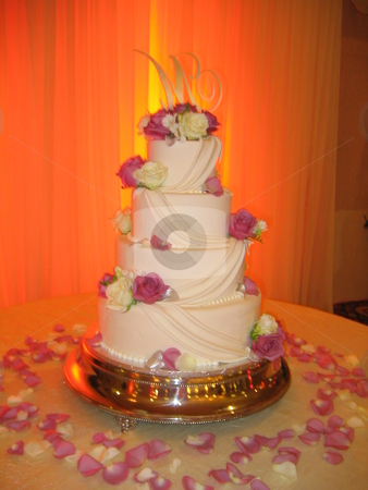 Wedding Cake stock photo, Four-tier Wedding Cake with drapes and flowers on cake stand.  Created by Cakes Made by M.E. by Michael Santero