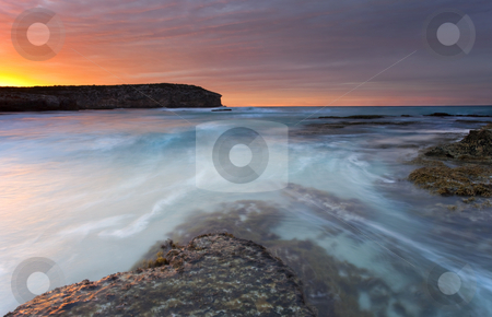 Divided Tides stock photo, Tides flowing around a sand bar at Pennignton Bay on Kangaroo Island at sunrise by Mike Dawson