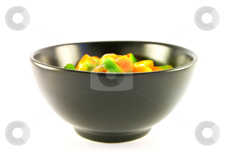 Chopped Chillis stock photo, Chopped chillis in a black bowl with clipping path on a white background by Keith Wilson
