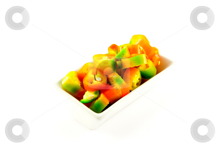 Chopped Chillis stock photo, Red, yellow and green chillis chopped in a dish with clipping path on a white background by Keith Wilson