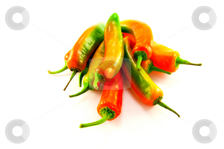 Pile of Chillis stock photo, Pile of red and green chillis with clipping path on a white background by Keith Wilson