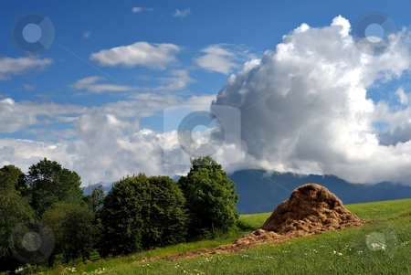 Haystack stock photo, Haystack on summer meadow with sky and gorgeous cloud by Juraj Kovacik