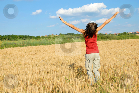 Happy girl jumping in wheat field stock photo, Happy girl jumping in yellow wheat field at scenic rural background by Julija Sapic