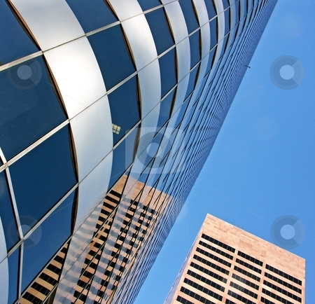 Two buildings stock photo, A glass and chrome building and a brick building by Cora Reed