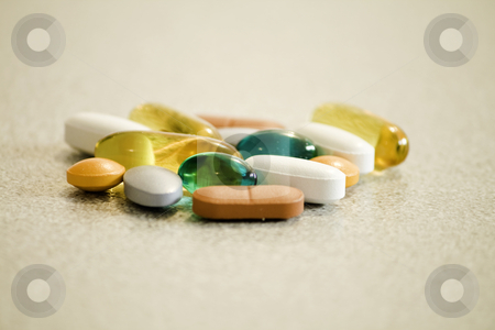 Vitamines stock photo, Some colourfull medication and vitamine pills by Arek Rainczuk