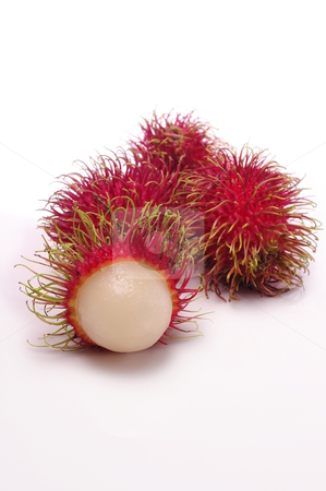 Rambutan stock photo, Hairy bright red tropical rambutan fruit. Shallow depth of field by Martin Darley