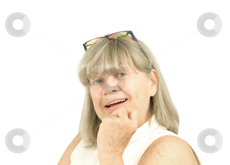 Portrait of smiling senior woman stock photo, Portrait of smiling senior woman on a white background by John Teeter