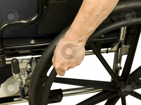 Older hand on wheel chair stock photo, Older hand on wheel chair pushing by John Teeter