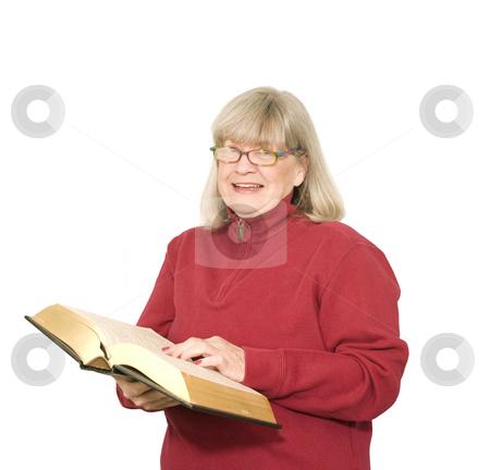 Senior woman reading stock photo, Senior woman reading on a white background by John Teeter