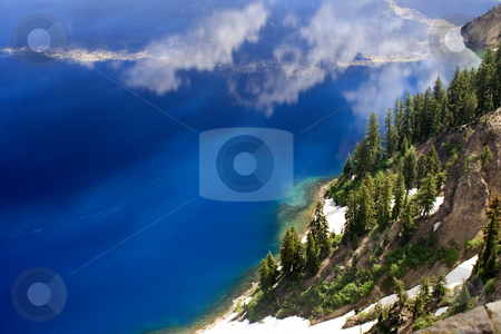 Blue Water Crater Lake National Park Oregon stock photo, Blue Water Crater Lake National Park Oregon.  Since crater lake is one of the deepest lakes in the world with exceptionally clear water, it creates a natural deep blue water.  No saturation has been added to this file. by William Perry