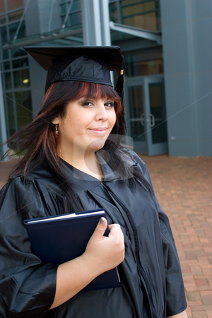 Graduate With a Diploma stock photo, A recent graduate thinks about what she will do now that she has completed her education. by Todd Arena