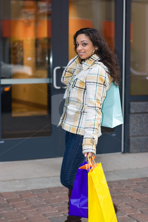 Woman Shopping stock photo, An attractive girl out shopping in the city. by Todd Arena
