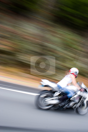 Blonde Biker Girl stock photo, Abstract blur of a pretty girl driving a motorcycle at highway speeds.  Intentional motion blur. by Todd Arena