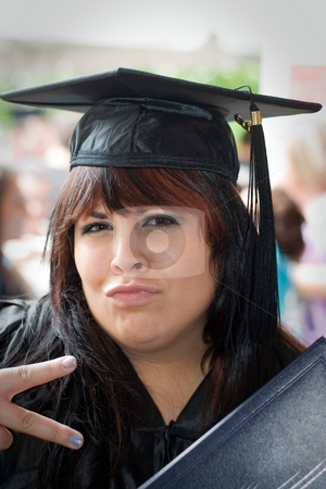 Happy Graduate stock photo, A young woman just receiving her diploma with a fun pose. by Todd Arena