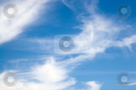 Whispy Blue Clouds stock photo, Fluffy cotton like clouds spread across a bright blue sky. by Todd Arena