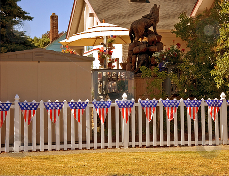 Home Fence Decorated 4th Of July stock photo, This home's fence is decorated with a 4th of July theme for a festive setting. by Valerie Garner