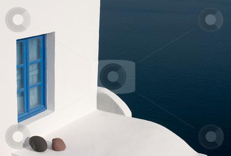 Blue window stock photo, White wall with blue window and stones by Wiktor Bubniak