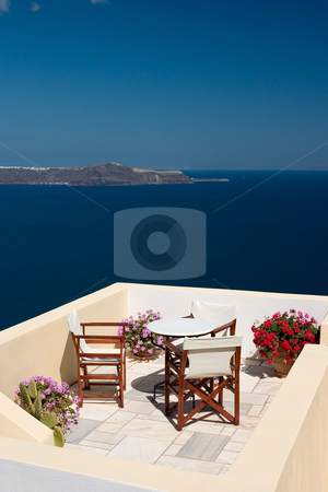 Holiday view from the balcony stock photo, Beautiful view from balcony on the Santorini island by Wiktor Bubniak