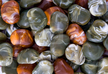Heap of decorative stones stock photo, Stack of decorative shining colorful pebbles by Wiktor Bubniak