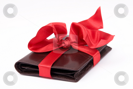 Leather wallet gift stock photo, Leather brown wallet gift with big red bow by Wiktor Bubniak