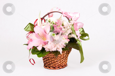 Basket of flowers stock photo, Basket full of variety flowers and green bow by Wiktor Bubniak