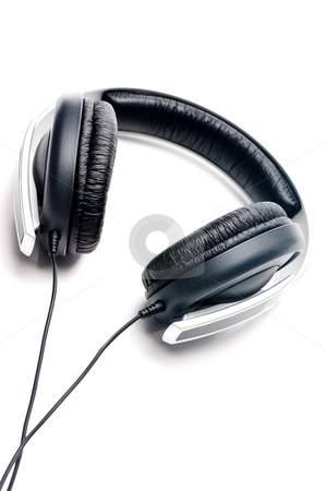 Tilted vertical image of silver colored headphones with black le stock photo, Tilted vertical image of silver colored headphones with black leather padding by Vince Clements