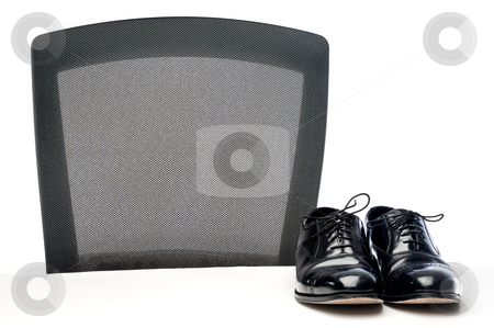 A pair of black formal business dress shoes on a white desk by a stock photo, A pair of black formal business dress shoes on a white desk by a chair by Vince Clements