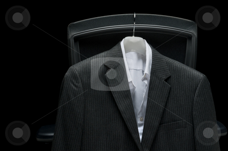 Business jacket and white shirt hanging on a chair stock photo, Business jacket and white shirt hanging on a chair by Vince Clements