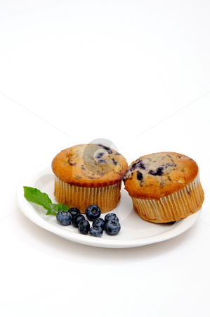 Two Muffins On A Saucer stock photo, Blueberry muffins on a white plate with fresh berries on the side by Lynn Bendickson