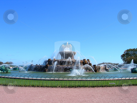 Fountain in Chicago Millennium Park  stock photo, Buckingham Fountain in Chicago Millennium Park against clear blue sky by Daniela Mangiuca