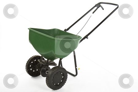 Seed fertilizer spreader stock photo, Green seed fertilizer spreader on white back ground by Chris Roselli