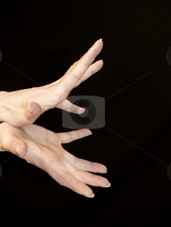Hands stock photo, Hands expressing opening up on black by Cora Reed