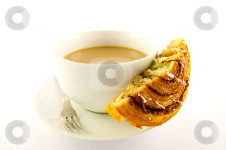 Half Cinnamon Bun and Tea stock photo, Half a cinnamon bun with a cup of tea and fork with clipping path on a white background by Keith Wilson
