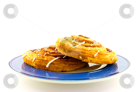 Cinnamon Buns on a Blue Plate stock photo, Two cinnamon buns on a blue plate with clipping path on a white background by Keith Wilson