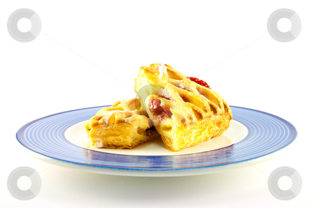 Raspberry Danish on a Plate stock photo, Raspberry and custard danish on a blue and white plate on a white background by Keith Wilson