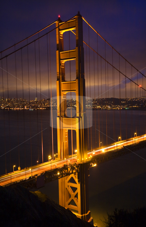 Golden Gate Bridge Night Vertical San Francisco California stock photo, Golden Gate Bridge Night Vertical With Lights of San Francisco California in background by William Perry