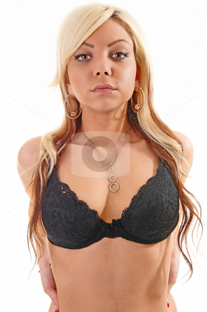 Girl in black bra. stock photo, A young blond girl with long hair shooing her chesr with an black bra and looking straight in the camera. by Horst Petzold