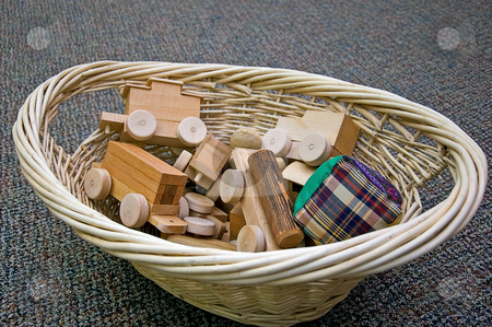 Wicker Basket of Toys stock photo, This wicker basket is full of handmade toys, a fabric square ball, and a wooden train. by Valerie Garner